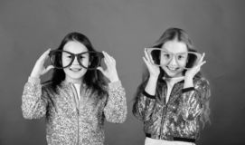 Glamorous little clubbers. Small kids in party glasses having fun. Cool party girls wearing fancy glasses. Party girls. In fashion glasses. Happy children enjoy royalty free stock image