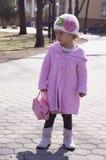 Glamorous little girl walking Royalty Free Stock Images