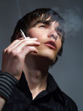 Glamorous looking smoker Royalty Free Stock Images