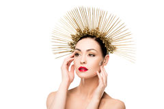 Glamorous model posing in golden headpiece and touching her face Royalty Free Stock Photo