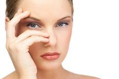 Glamorous model posing hand on face Royalty Free Stock Photos