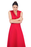 Glamorous model in red dress being cold Stock Photo