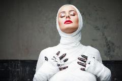 Free Glamorous Mummy. Portrait Of A Young Beautiful Woman In Bandages All Over Her Body Stock Photo - 134060200