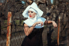 Glamorous nun in the park. Stock Photography