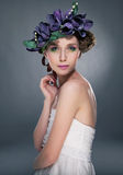 Glamorous nymph in wreath of flowers Royalty Free Stock Images