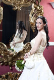 Glamorous photo of a beautiful brunette bride in hotel Stock Image