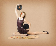 Glamorous pinup girl holding vinyl LP records Royalty Free Stock Images