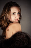 Glamorous portrait of a beautiful woman. In a fur coat Stock Image