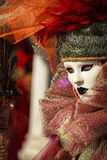 Glamorous portrait with venetian mask, amazing colored hat and beautiful eyes during venice carnival Stock Image
