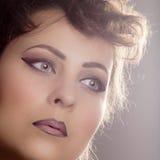 Glamorous retro makeup. Beautiful female face with perfect complexion and glamorous retro makeup Royalty Free Stock Images