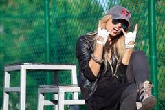 Glamorous rocker girl in glasses and baseball cap Stock Photography