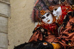 Glamorous and romantic couple with beautiful eyes and venetian mask during venice carnival Royalty Free Stock Image