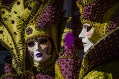 Glamorous and romantic couple with costume and venetian mask during venice carnival Royalty Free Stock Photo