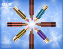 Glamorous Set of tubes with lip colour balm on the sparkling effects background Royalty Free Stock Images