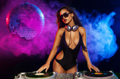 Glamorous sexy busty DJ Stock Photos