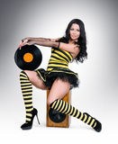 Glamorous young girl with vinyl on speaker Royalty Free Stock Image