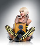 Glamorous sexy young girl with wooden speaker Stock Photography