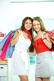 Glamorous shopaholics Stock Images