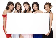 Glamorous Sign #1. Five attractive asian women holding a big blank sign Stock Photos
