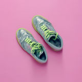 Glamorous sneakers on pink background Royalty Free Stock Images