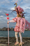 Glamorous and stylish aristocrat performer during venice carnival. Glamorous, stylish and original aristocrat model with pink costume and beautiful walking stick Stock Photography