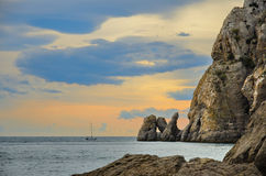 Glamorous sunset on the rocky shore of the Black sea, Crimea, Novy Svet. Royalty Free Stock Images