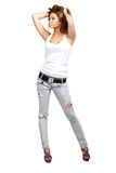 Glamorous woman. Glamorous young woman in shirt and jeans on white background Stock Images