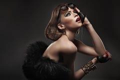 Glamorous woman. In amazing pose Royalty Free Stock Image