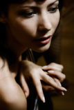 Glamorous woman. Mysterious low-key portrait of beautiful glamorous woman. Soft-focused. Focus is on eye Stock Photo