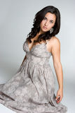 Glamorous Woman. Beautiful glamorous woman wearing dress Royalty Free Stock Images