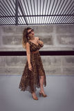 Glamorous woman in animal print outfit maxi dress Stock Photo