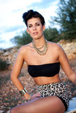 Glamorous woman in animal print shorts Stock Photography