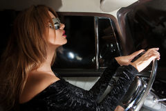 Glamorous woman behind the wheel in the car Royalty Free Stock Image
