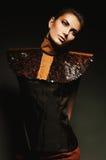 Glamorous woman bending neck. In dark Stock Images
