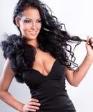 Glamorous woman with black dress Royalty Free Stock Photo