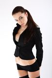 Glamorous woman in black stockings and jacket. Stock Photos