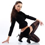 Glamorous woman in black stockings and jacket. Stock Images