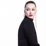 Glamorous woman in black. Glamorous young woman in black turtleneck posing on white background Stock Photos