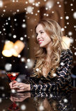 Glamorous woman with cocktail at night club or bar. New year party, christmas, winter holidays and people concept - glamorous woman with cocktail at night club Royalty Free Stock Image