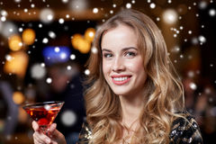 Glamorous woman with cocktail at night club or bar Royalty Free Stock Photography