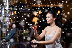 Glamorous woman with cocktail at night club or bar. New year party, christmas, winter holidays and people concept - glamorous woman with cocktail at night club Stock Image