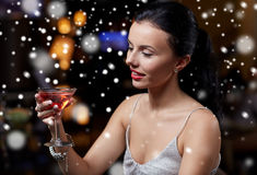 Glamorous woman with cocktail at night club or bar. New year party, christmas, winter holidays and people concept - glamorous woman with cocktail at night club Stock Photography