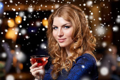 Glamorous woman with cocktail at night club or bar. New year party, christmas, winter holidays and people concept - glamorous woman with cocktail at night club Stock Photos