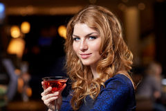 Glamorous woman with cocktail at night club or bar. People, party, nightlife, drink and holidays concept - glamorous woman with cocktail at night club or bar Stock Photography