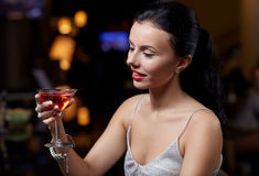 Glamorous woman with cocktail at night club or bar Royalty Free Stock Photo
