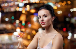 Glamorous woman with cocktail at night club or bar. People, party, nightlife, drink and holidays concept - glamorous woman with cocktail at night club or bar Royalty Free Stock Photos