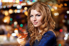 Glamorous woman with cocktail at night club or bar. People, party, nightlife, drink and holidays concept - glamorous woman with cocktail at night club or bar Royalty Free Stock Photo