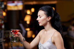 Glamorous woman with cocktail at night club or bar. People, party, nightlife, drink and holidays concept - glamorous woman with cocktail at night club or bar Royalty Free Stock Image