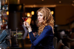 Glamorous woman with cocktail at night club or bar Stock Photo