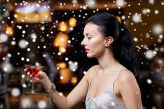 Glamorous woman with cocktail at night club or bar. People, party, nightlife, drink and holidays concept - glamorous woman with cocktail at night club or bar Royalty Free Stock Photography